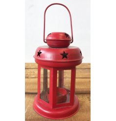 A charming red metal lantern with cut out star detailing. Ideal for displaying a t-light this season.