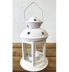 A chic white metal lantern with star detailing. A lovely decoration to hold a t-light candle.