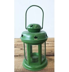 A charming green metal lantern with cut out star detailing.