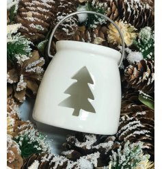 A simple yet sweet porcelain lantern, set in a glossy white tone and finished with a fir tree opening and metal handle