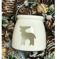 A simple yet sweet porcelain lantern, set in a glossy white tone and finished with a reindeer opening and metal handle