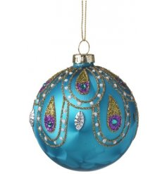 A beautifully coloured bauble decorated with gems and a glitter leaf design.