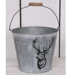 A large Zinc Bucket featuring a distressed setting and an added Stag motif.