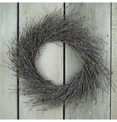 A charming rustic twig wreath with sprawled inspired design and grey wash tone
