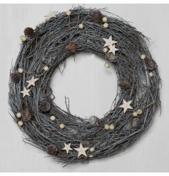 Decorated with a soft grey tone and covered with assorted berries, stars and pinecones