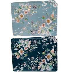 A set of 4 beautiful blue daisy floral placemats. A lovely gift item and table decoration.