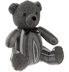 A cute teddy bear design doorstop with grey striped and a herringbone design. Complete with a charming bow.