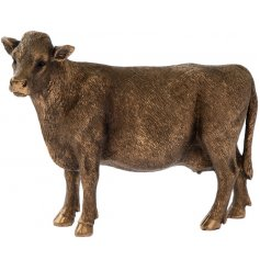A fine quality cow figurine from the popular bronzed reflections range. A country living gift item
