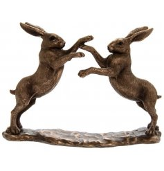 A fine quality bronzed reflections ornament featuring twin boxing hares.