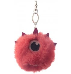 A funky and fluffy pom pom key ring with a monster design.