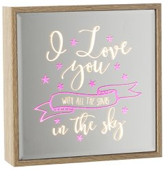 A wooden framed mirror with pink sparkles and light up sign.