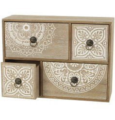 A beautiful 4 drawer wooden cabinet with a shabby chic carved pattern and vintage inspired metal handles.