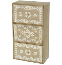 A beautiful 3 drawer storage unit with a carved decorative pattern in cream. Complete with small wooden handles.