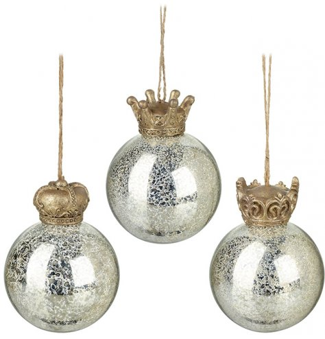 An assortment of 3 vintage inspired glass baubles with an antique mottled finish and gold painted crowns.