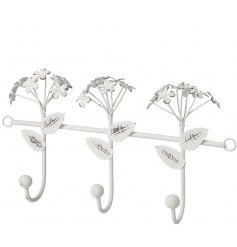 A shabby chic hook with 3 pretty flowers, each with a distressed finish.