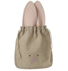 An adorable bunny design natural drawstring bag. Ideal for filling with chocolate eggs and gifting.