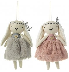 An assortment of 2 hippy rabbit hangers with faux fur skirts and floppy ears. Complete with a wooden heart bead.