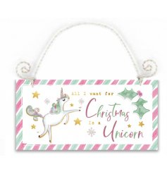 A colourfully magical wooden sign with a mint green and pink candy cane edging and pretty unicorn decal