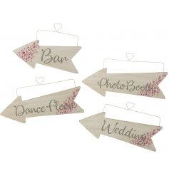 A mix of 4 stylish confetti heart design wooden arrows, directing guests to the wedding, bar, dancefloor and photo booth