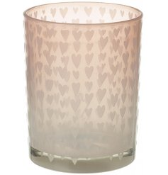 A glass t-light holder with pretty pink love hearts.