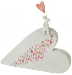 An adorable and unique heart shaped decoration with a charming little mouse holding a heart shaped balloon.