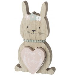 A chunky wooden bunny decoration with a beaded necklace and a Happy Easter cut our heart decoration.