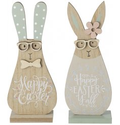 An assortment of 2 wooden rabbit decorations in pretty pastel colours. Each has a Happy Easter slogan