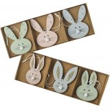 A set of pretty bunny decorations, each with pom pom noses and glitter ears. Each box includes pink, blue and green