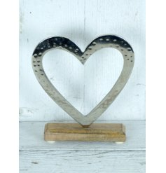 A rustic style heart decoration with a hammered finish. Set upon a chunky wooden mango base.