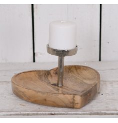 A chunky heart shaped wooden base set with a distressed silver candle holder centre