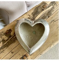 A decorative silver heart dish with a hammered finish. A unique gift item and interior accessory. We love!