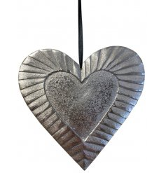 A chic aluminium hanging heart decoration with a textured pattern.
