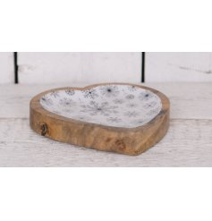 A chic heart shaped tray with an enamel snowflake design. A charming interior decoration.
