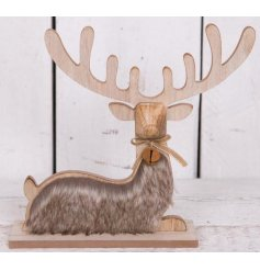 A rustic style woodland reindeer with geometric features and a faux fur coat. A rustic bell with bow detail.