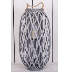 this extra large woven willow lantern will be sure to place perfectly in any home space