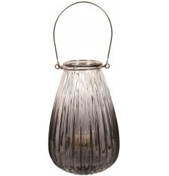 A chic lantern with ribbed glass and an ombre finish.