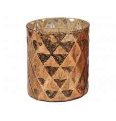 A chic copper candle holder with an aged antique inspired finish.