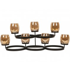 Chic and stylish glass candle holders set within a black framework. A beautiful statement item for the home.