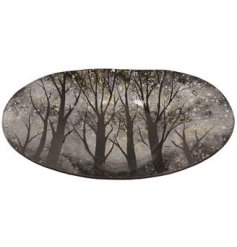 A stylish glass bowl with a decorative winter scene, complete with black and gold speckles.