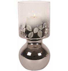 A chic glass hurricane candle holder with a leaf design.