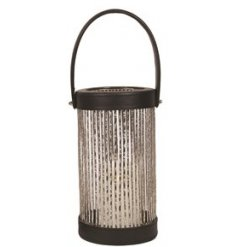 A chic lantern with silver glitter cage and handle.