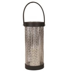 A chic and stylish tall lantern with handle and silver glitter cage. A unique interior accessory for the home.