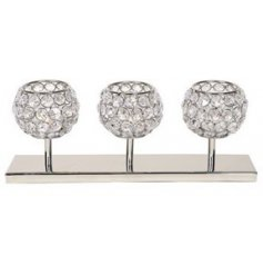 Create ambience in the home with this chic crystal design t-light holder set upon a silver base.