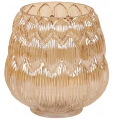 A chic hurricane vase with a gold lustre finish and decorative pattern.
