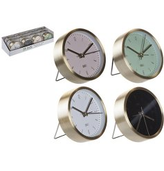 Assorted table alarm clocks each set with an Aluminium base surround and coloured clock face