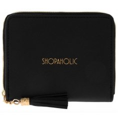 A stylish black and gold purse with a shopaholic slogan and tassel zip.