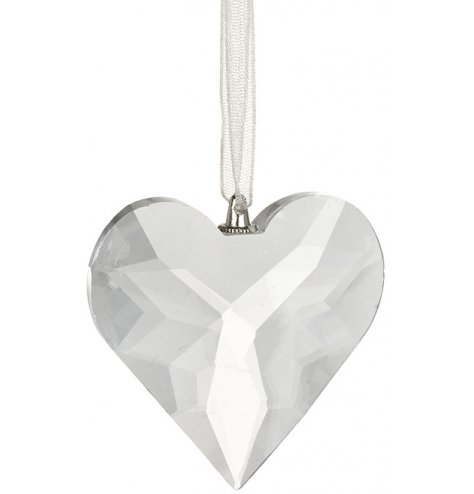 A diamond cut heart shaped hanger with clear organza ribbon hanger.