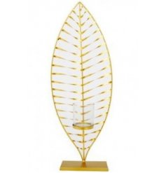 A beautiful gold leaf ornament with a glass candle holder, ideal for displaying a votive or t-light.