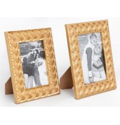 A stylish and on trend gold photo frame with a woven pattern. A lovely gift item and interior accessory.
