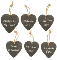 An assortment of hanging slate heart decorations each set with their own sweetly scripted text